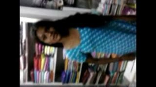 Indian young Student Relaxed on Inside Of book shop – Wowmoyback